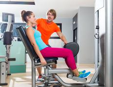 Hip abduction woman exercise at gym closing - stock photo