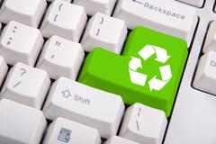 recycle symbol on the computer keyboard - stock photo