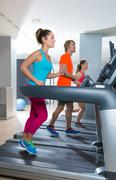 Gym treadmill group running indoor Stock Photos