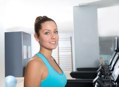 Gym treadmill women indoor exercise blue eyes - stock photo