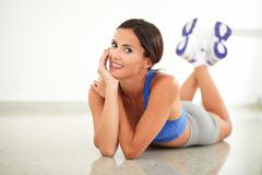 Beautiful woman in sportswear looking at you in yoga class - copyspace - stock photo