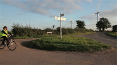 CYCLIST & HORSE AT COUNTRYSIDE JUNCTION, GILMORTON, LEICESTERSHIRE, ENGLAND Stock Footage