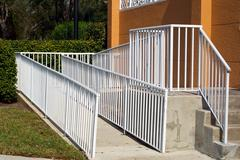 Handicap ramp with white railing Stock Photos