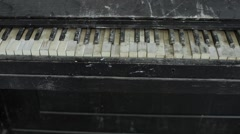 Pan shot over the keyboard of an old piano Stock Footage