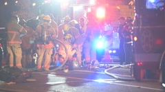 Car wreck lots of firefighters Stock Footage