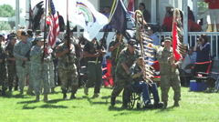 Military Veterans lead grand entry at pow wow Stock Footage