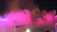 Smoke pouring from a structure fire with embers going in the air Stock Footage