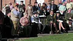 GROUP OF PEOPLE WATCH WORLD WAR 2 RE-ENACTORS, PICKERING, NORTH YORKSHIRE Stock Footage