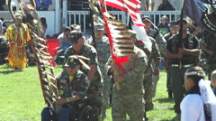 Military veterans lead in pow wow grand entry Stock Footage