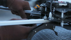 Man's Hands Repairing and Working on High Tech Drone - stock footage