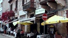 Cyprus Greek side Limassol 007 restaurant with yellow sunshades Stock Footage