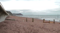 View Across Teignmouth Beach Gentle Sea on a Overcast Day Stock Footage