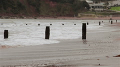 View Across Teignmouth Beach as Sea Waves Washes Sand Gently on a Overcast Day Stock Footage