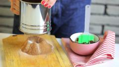 Hand sifts the flour and cocoa  through a sieve Stock Footage