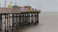 Deserted Teignmouth Pier - Pillars Stretch Across Calm Sea - Cloudy Overcast Day Stock Footage