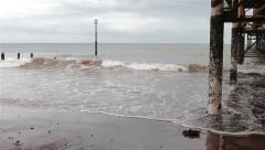 Waves Wash Through Pillars of Pier - View of the Sea at Teignmouth Beach, Devon Stock Footage