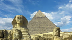 Clouds over great pyramid and sphinx in Egypt - timelapse Stock Footage