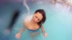 4k Attractive Female enjoying waterfall jet shower at water hydrotherapy trea Stock Footage