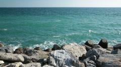 Waves splashing the rocks in turquoise Mediterranean Sea Stock Footage