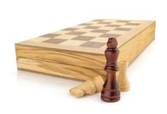 chess figures and board isolated at white - stock photo