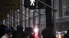 NEW YORK - FEBRUARY 2, 2015: Pedestrians wait and move slowly through an interse - stock footage