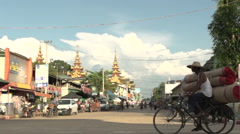Pathein, traffic in the street at the Shwemokehtaw Pagoda Stock Footage