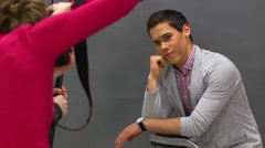 Guy model posing for girl photographer photo shooting Stock Footage