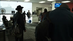Hassidic orthodox Jewish man hat waiting LAX terminal airport LA Stock Footage