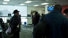 Bearded Hassidic orthodox Jew waiting crowded LAX airport terminal Stock Footage