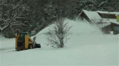 Heavy Snow Removal Equipment clearing neighborhood streets Stock Footage