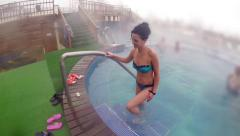 Sexy female in bikini ascending the stairs in the spa thermal pool, slow moti Stock Footage