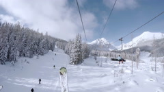 Ski lift in snowy Tatras Mountain resort Stock Footage