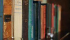Old Books On Shelf Rack Focus Stock Footage
