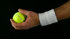 Tennis player's hand ready to toss the tennis ball before hitting it Stock Footage