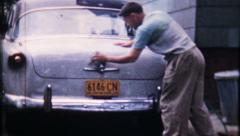 1709 - man hand washes his 1953 Ford - vintage film home movie Stock Footage