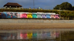 Colorful Changing Rooms Are Reflected on the Wet Sand Stock Footage