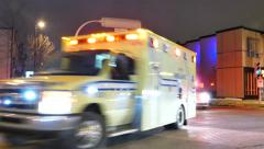 4K UHD - Ambulance driver uses PA to shout to pedestrians to get out of the way Stock Footage
