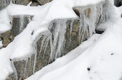 Snow on rock Stock Photos