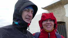 Adult Couple Resist Hurricane Winds, closeup Stock Footage