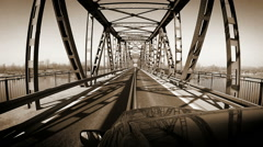 Old beige sepia: on-the roof camera - car on the steel bridge Stock Footage