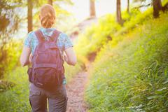 Woman Hiking in Alpine Forest - stock photo