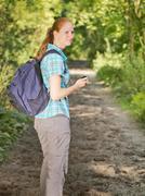 Hiker Navigating with GPS - stock photo