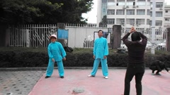 China Wushu Taijiquan, the citizens in practice Stock Footage