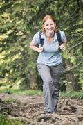 Active Tourism - Woman Hiking - stock photo