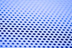 Closeup Image of Perforated Metal - stock photo