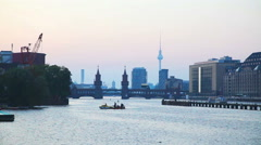 Berlin cityscape with Oberbaum bridge in the evening Stock Footage