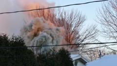 4K UHD - Strong wind creating beautiful effect in smoke coming out of house fire Stock Footage