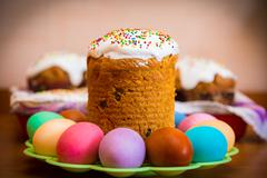 Sweet Easter cake with colorful eggs Stock Photos