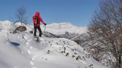 Winter hiking. A trekker walks in the snow. Stock Footage