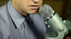 Commentator Speaking Into Microphone Close - stock footage